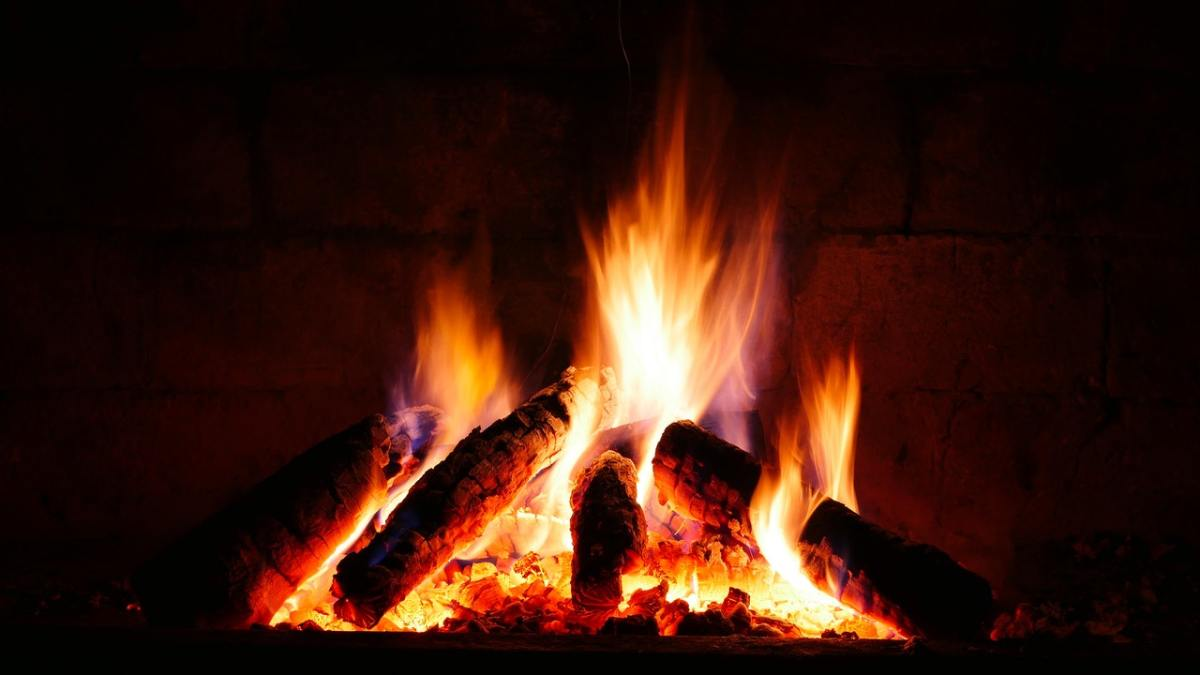 A fiery stack of wood logs.