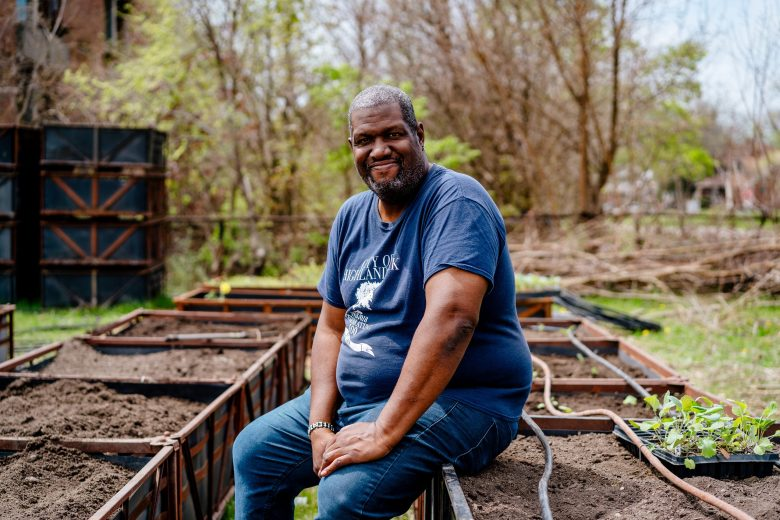 Juan Shannon photographed at the Parker Village garden and aquaponics operation.
