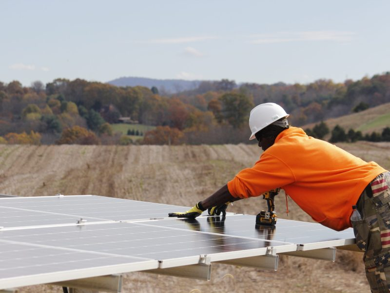 Workers install solar panels at Carilion New River Valley Medical Center in Montgomery County, Virginia.