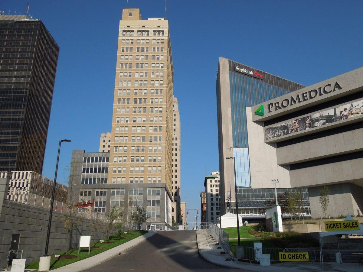 A skyscraper and a stadium in Toledo Ohio.