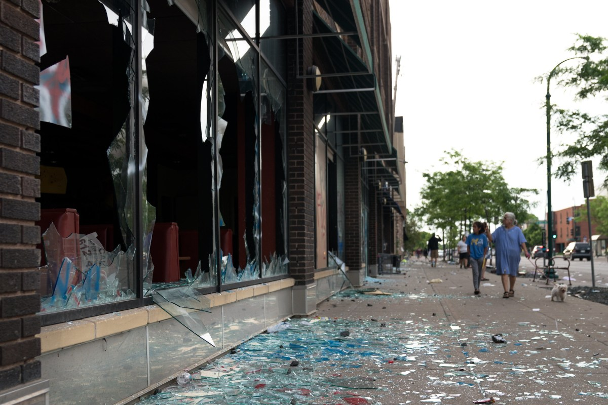 Broken windows along Lake Street in Minneapolis last May.
