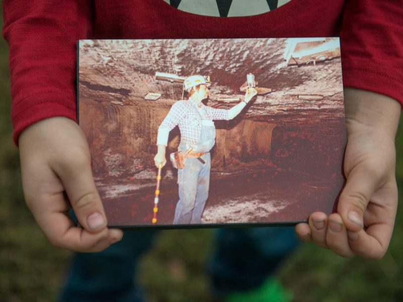 Luke Campbell, then 6, holds a picture of his grandfather Glen Campbell in late 2018.