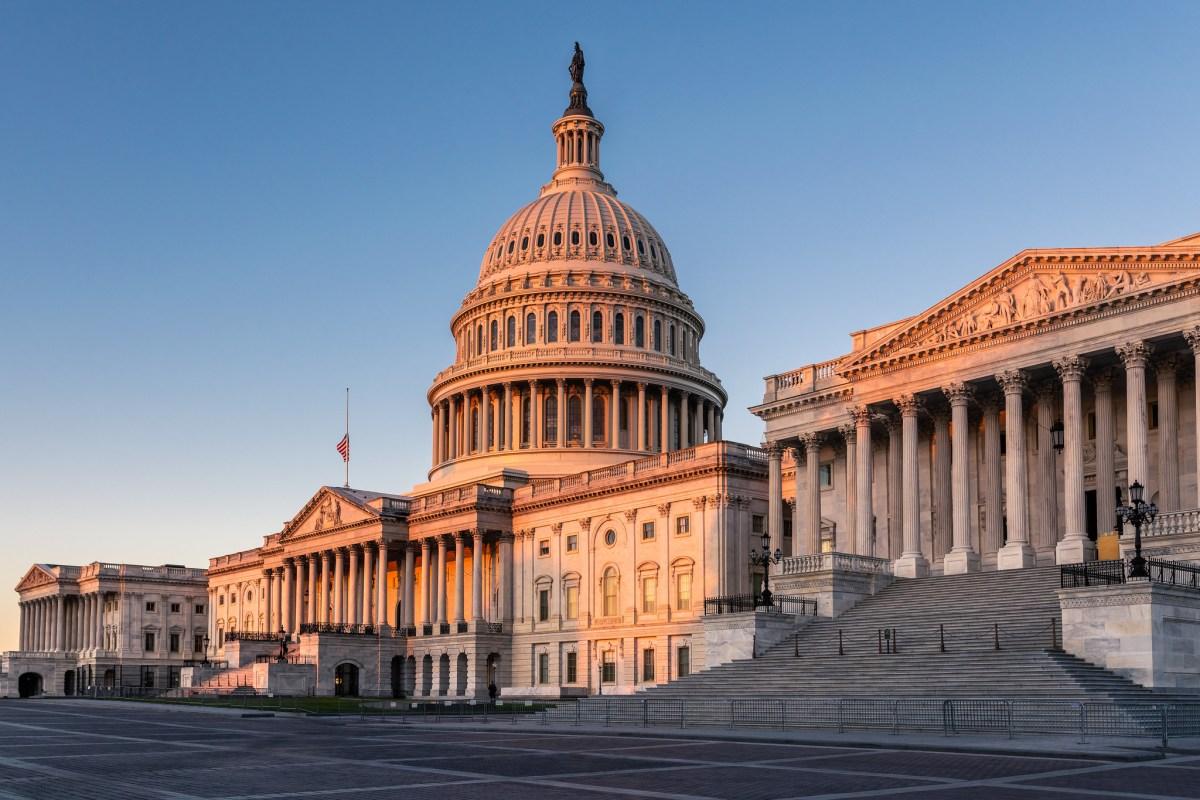 The U.S. Capitol Building at sunrise.