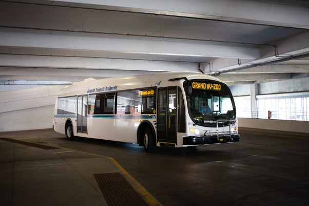 An electric bus in a parking garage.