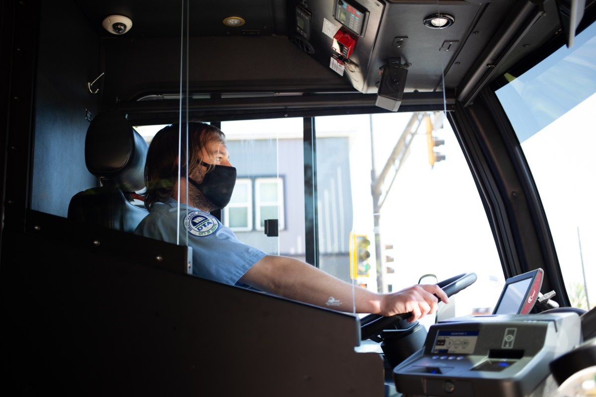 Ted Manteuffel, a bus driver in Duluth, wears a mask as he drives the bu