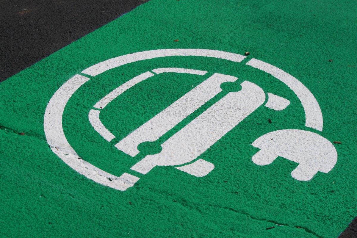EV charging symbol on pavement