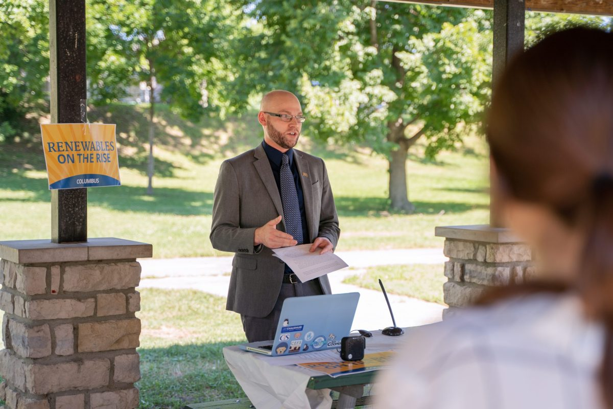 Gilbert Michaud speaks to community stakeholders at an event.