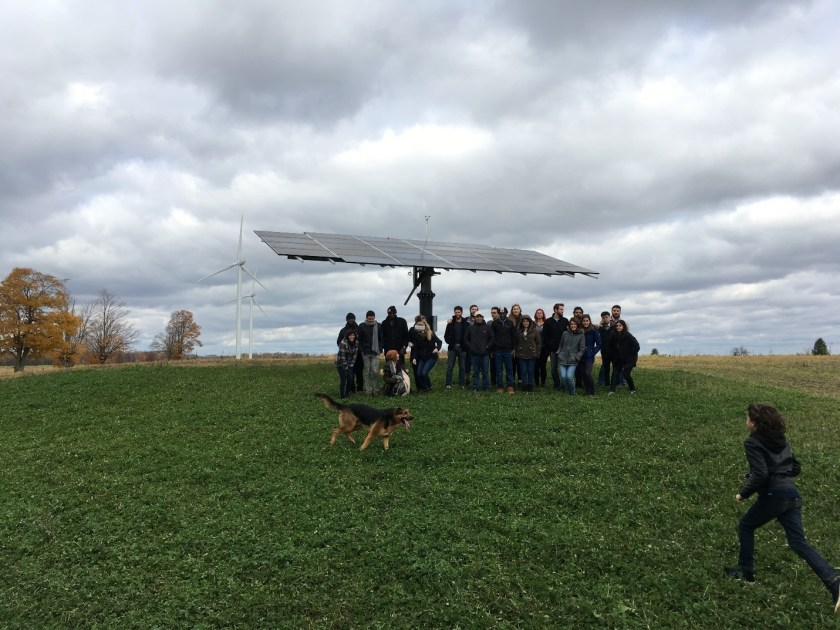 students stand in front of Solar panel in York, Oxford County, Canada