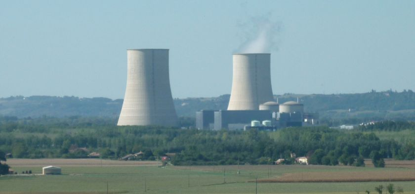 nuclear plant Golfrech shown from a field, steam coming from one tower