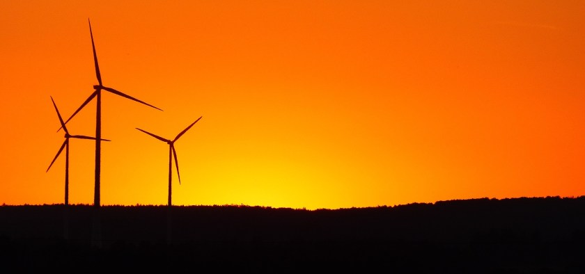 Windmills against a bright sunset