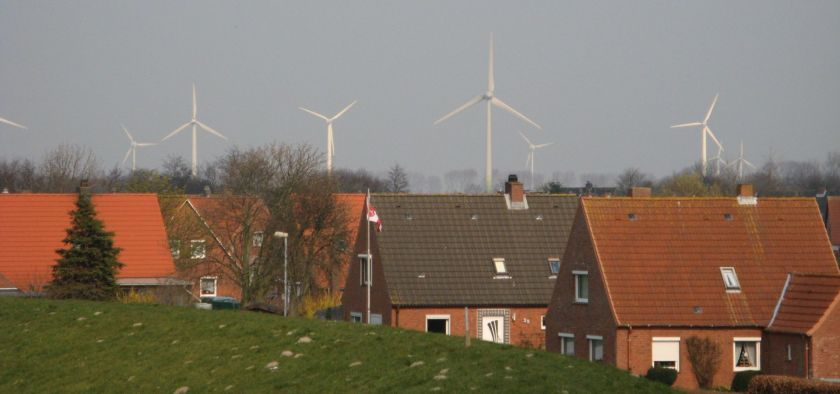 small red brick houses with windmills in the background