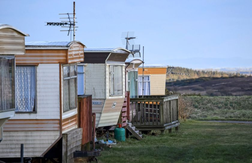 two run-down mobile homes with a view of the horizon