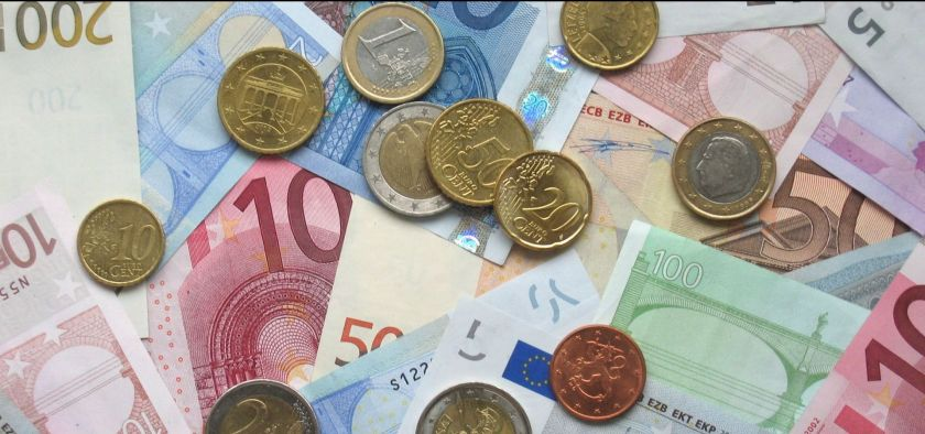 bank notes and various euro coins