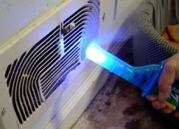 Wizard Stick being used to find air leakage during a Blower Door test