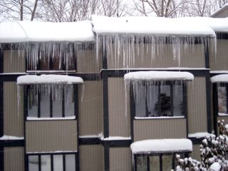 Ice dams at the eave from heat loss in the attic due to a weak building envelope