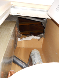 water heater and hvac furnace closet open to attic from hallway