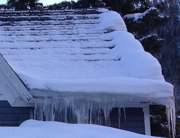 roof ice dam attic heat loss cute house closeup