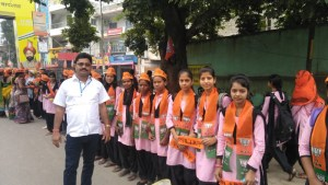 bjp and students Chief Minister Raghubar Das symbol Ranchi Giridih children school jharkhand party flags