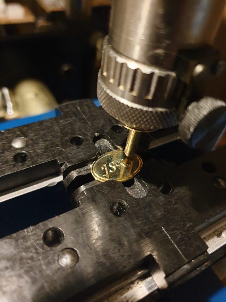 Solid Gold Cufflink being Engraved