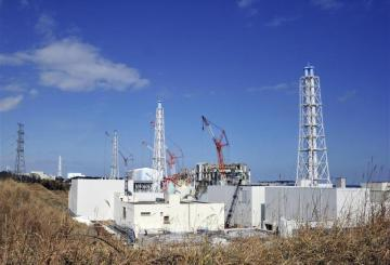 The crippled TEPCO's Fukushima Daiichi nuclear power plant reactor buildings are seen in Fukushima prefecture