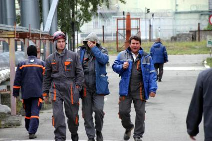 Workers at the Chernobyl nuclear power plant walking to the new containment structure.