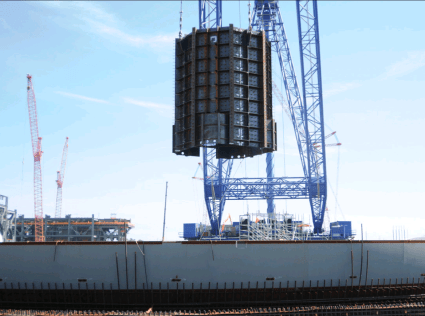 SCE&G workers place the reactor vessel cavity, which will contain the reactor vessel, into the bottom of the containment vessel on June 29th, 2015.