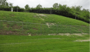 A picture of stormwater runoff flowing down the side of the West Lake Landfill in Bridgeton, Missouri into a ditch alongside St. Charles Rock Road.