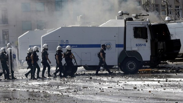 Turkish riot police clash with protesters in Taksim Square
