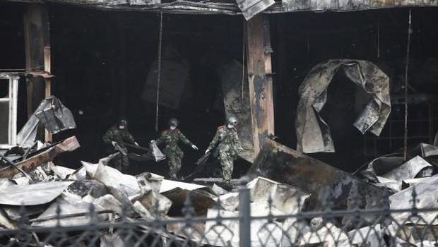 Fire, locked doors kill 119 at China poultry plant