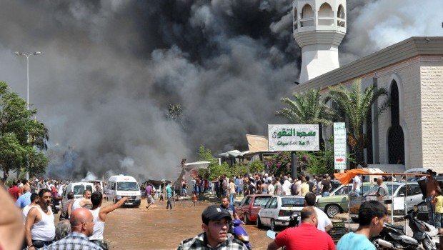 At least 13 killed in blasts outside two mosques in Lebanon's Tripoli
