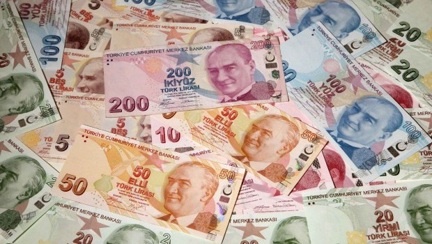 Turkish central bank hints at action as corruption row, Fed sink lira