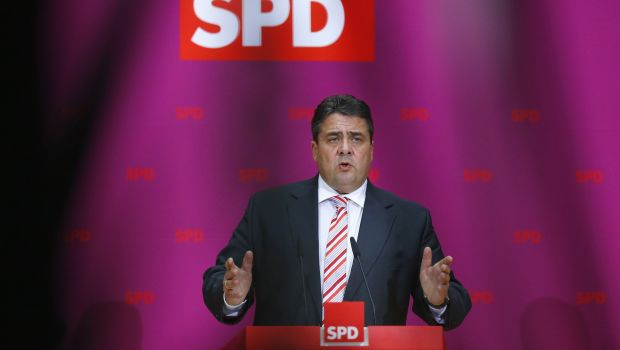 Germany's SPD backs coalition talks with Merkel, sets terms