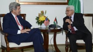 A handout photograph released by the Palestinian Authority shows US Secretary of State John Kerry, left, as he is greeted by Palestinian Authority President Mahmoud Abbas, right, upon his arrival at the Palestinian Authority's headquarters in the West Bank town of Ramallah, on January 3, 2014. (EPA/Thaer Ganaim/Palestinian Authority)