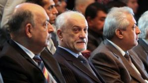 Iraqi Deputy Prime Minister for Energy Hussein Al-Shahristani, center, listens during a meeting gathering politicians and oil experts to discuss the export of oil from Iraq's northern Kurdish region on February 1, 2014 in the Iraqi capital, Baghdad. (AFP Photo/Sabah Arar)