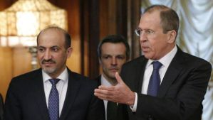Russian Foreign Minister Sergey Lavrov, right, welcomes Ahmad Al-Jarba, left, who heads a delegation of the Syrian National Coalition prior to talks in Moscow on Tuesday, February 4, 2014. (AP Photo/Alexander Zemlianichenko)