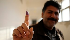 A man shows his ink-stained finger after casting his ballot during a vote to elect a constitution-drafting panel in Benghazi February 20, 2014. Libyans head to the polls on Thursday to elect a body to draft a new constitution, marking a step in the country's transition after the overthrow of dictator Muammar Gaddafi in 2011. REUTERS/Esam Omran Al-Fetori (LIBYA - Tags: POLITICS ELECTIONS TPX IMAGES OF THE DAY)