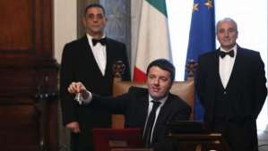 Italian new Premier Matteo Renzi rings the bell for reporters to indicate the start of his first cabinet meeting at Chigi Palace Premier's office, in Rome, Saturday, Feb. 22, 2014. Renzi has been sworn in as Italy's youngest premier, heading a new government he says promises will swiftly tackle old problems. Renzi had been serving as Florence mayor when he engineered a power grab last week to effectively force fellow Democrat, Enrico Letta, to step down after 10 months at the helm of a fragile, often-squabbling coalition. (AP Photo/Riccardo De Luca) Management
