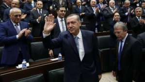 """Turkey's Prime Minister Tayyip Erdogan greets his supporters as he arrives for a meeting at the Turkish parliament in Ankara February 25, 2014. Erdogan said on Tuesday voice recordings purportedly of him telling his son to dispose of large sums of money on the day news broke of a graft inquiry were a """"treacherous attack"""" on his office. REUTERS/Umit Bektas (TURKEY - Tags: POLITICS BUSINESS TPX IMAGES OF THE DAY)"""