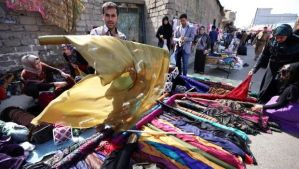 A vendor displays material used for traditional Kurdish costumes at a market on February 23, 2014 in Erbil, the capital of the autonomous Kurdish region of northern Iraq. (AFP Photo/Safin Hamed)