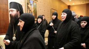 In this photo released by the Syrian official news agency SANA, a group of nuns who were freed after being held by rebels, greet church officials at the Syrian border town of Judaydat Yabus, early Monday, on March 10, 2014. (AP Photo/SANA)