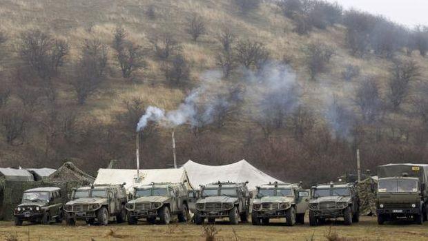 Russia holds war games near Ukraine, Merkel warns of catastrophe