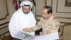 Egypt's army chief Field Marshal Abdel-Fattah El-Sisi, right, looks at drawings of houses with Hassan Ismaik, Arabtec's chief executive, at the Ministry of Defense in Cairo in this March 9, 2014 handout provided by Egypt's Ministry of Defense.( Reuters/Ministry of Defence/Handout via Reuters)