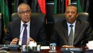 A file photo dated November 16, 2013 shows Libyan Prime Minister Ali Zeidan, left, and Libyan Minister of Defense Abdallah Al-Thani attending a press conference with members of the government, in Tripoli, Libya. (EPA/Sabri Elmhedwi)