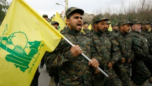 In this picture taken on Friday, February 14, 2014, Hezbollah fighters march in a parade during the memorial of their slain leader Sheik Abbas al-Mousawi, who was killed by an Israeli airstrike in 1992, in Tefahta village, south Lebanon. (AP Photo/Mohammed Zaatari)