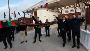 Police officers celebrate in front of a prison where Saadi Gaddafi, son of Muammar Gaddafi, is held, in Tripoli March 6, 2014. Niger has extradited Saadi, who just arrived in Tripoli and was brought to a prison, the Libyan government said on Thursday. The North African country had been seeking the extradition of Saadi, who had fled to the southern neighbour nation after the toppling of Gaddafi in a NATO-backed uprising in 2011. (REUTERS/Ismail Zitouny)