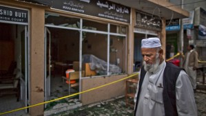 An elderly Pakistani man stands at the site of a twin suicide bombing in a court complex in Islamabad, Pakistan, on Tuesday, March 4, 2014. (AP Photo/Muhammed Muheisen)