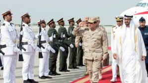Abu Dhabi's Crown Prince Sheikh Mohammed Bin Zayed Al Nahyan (R) and Egypt's army chief Field Marshal Abdel-Fattah El-Sisi (2nd R) review the honor guard upon Sisi's arrival to Abu Dhabi on March 11, 2014. (REUTERS/Emirates News Agency/WAM/Handout via Reuters)