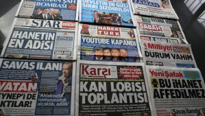 """The headlines of Turkish newspapers on Friday March 28, 2014, a day after Turkish authorities moved to block access to YouTube after an audio recording of a government security meeting was leaked on the video-sharing website. Some headlines read: """" Suleyman Shah Bomb; State Secrets Leaked; YouTube Blocked; Declaration of War; Meeting of Blood Lobby; Situation is Serious; Treason, Worse of Treason."""" (AP Photo/Burhan Ozbilici)"""