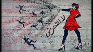 """Photo shows graffiti of a woman with the words """"no harassment"""" in Arabic, taken on June 23, 2012. (AP Photo/Maya Alleruzzo)"""