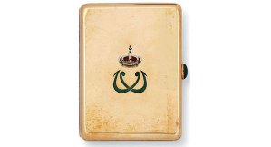 A golden cigarette case showing the monogram of King Farouk, made in Egypt between 1936 and 1952. (Photo courtesy of Christie's)